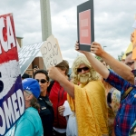 Jesus Christ dressed Erik Issacson, center, counter protests members of the Westboro Baptost Church alongside Montana State University students Monday afternoon on campus.