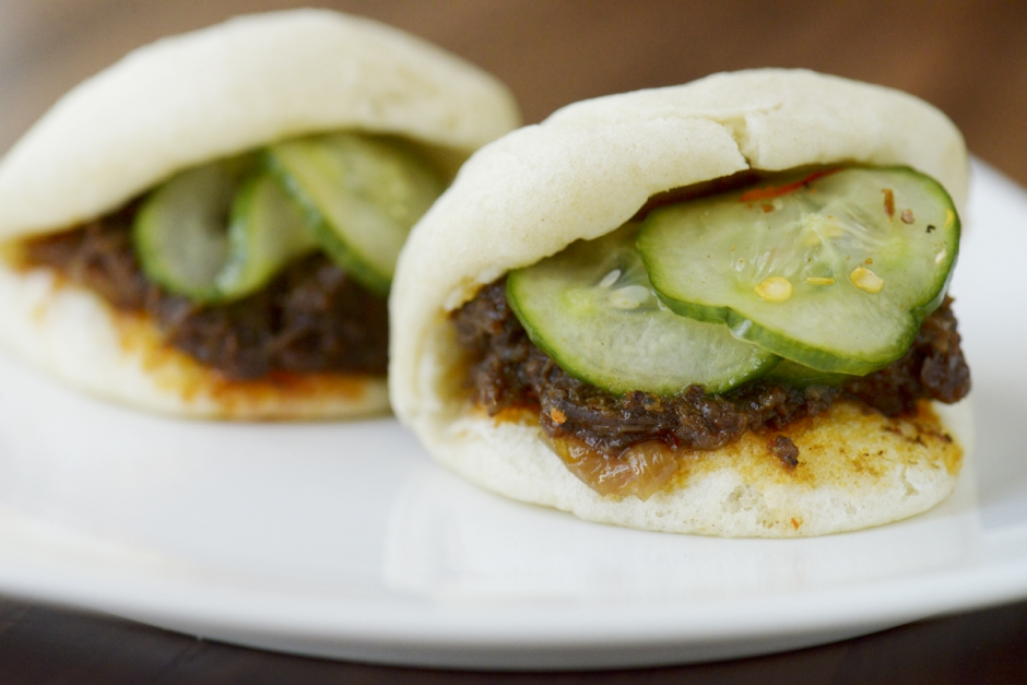 Mike Greener/Chronicle  Willow Spring Lanb Vindaloo Buns at the Saffron Table restaurant feature steamed flour buns with vindaloo curry topped with pickled cucumber and a spicy yogurt.