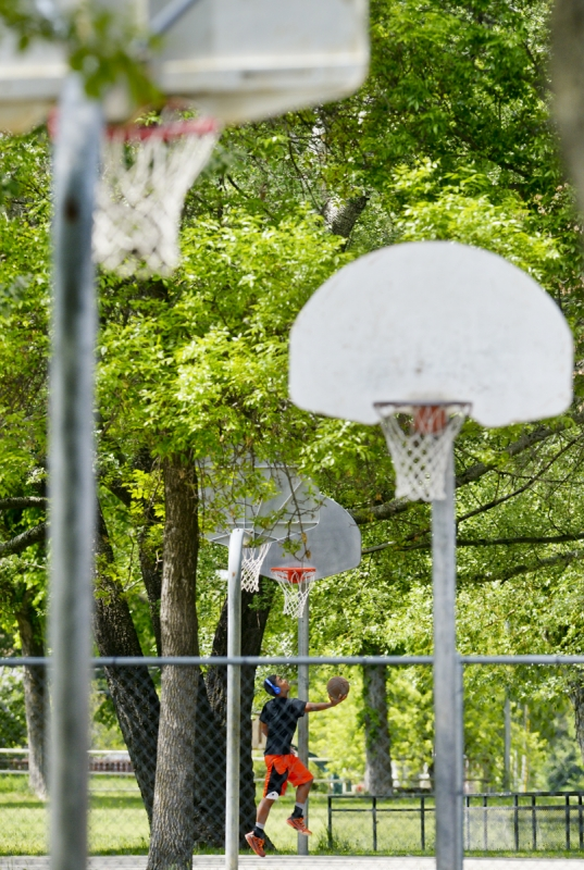Mike Greener/Chronicle  Manhattan High School junior Taylor Oldenburger, 16, practices on the school courts Friday afternoon in Manhattan. His team will be traveling to Columbus this weekend for their first basketball tournament of the summer.