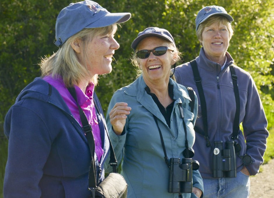 Mike Greener/Chronicle  Sacajawea Audubon Society members Loreene Reid, Paulette Epple and Lou Ann Harris, from left, share a laugh as they enjoy the morning bird activity at the Cherry River fishing access off Frontage Road in Bozeman.