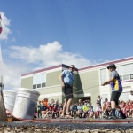 Mike Greener/Chronicle  Hawthorne Elementary School fifth grader Jeffery Wood launches his water rocket during a special last day of school event for graduating students Wednesday morning in Bozeman.