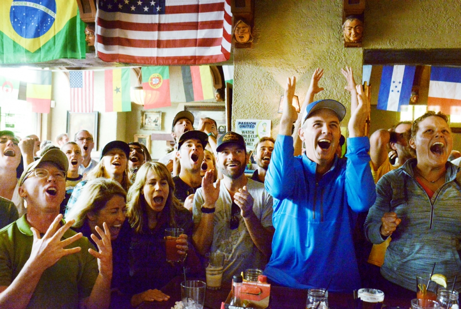 Mike Greener/Chronicle  Logan and Kim Dickerson, right, burst from their seats in reaction to a missed goal attempt by the United States during their World Cup match against Germany Thursday afternoon at the Bacchus Pub in downtown Bozeman.