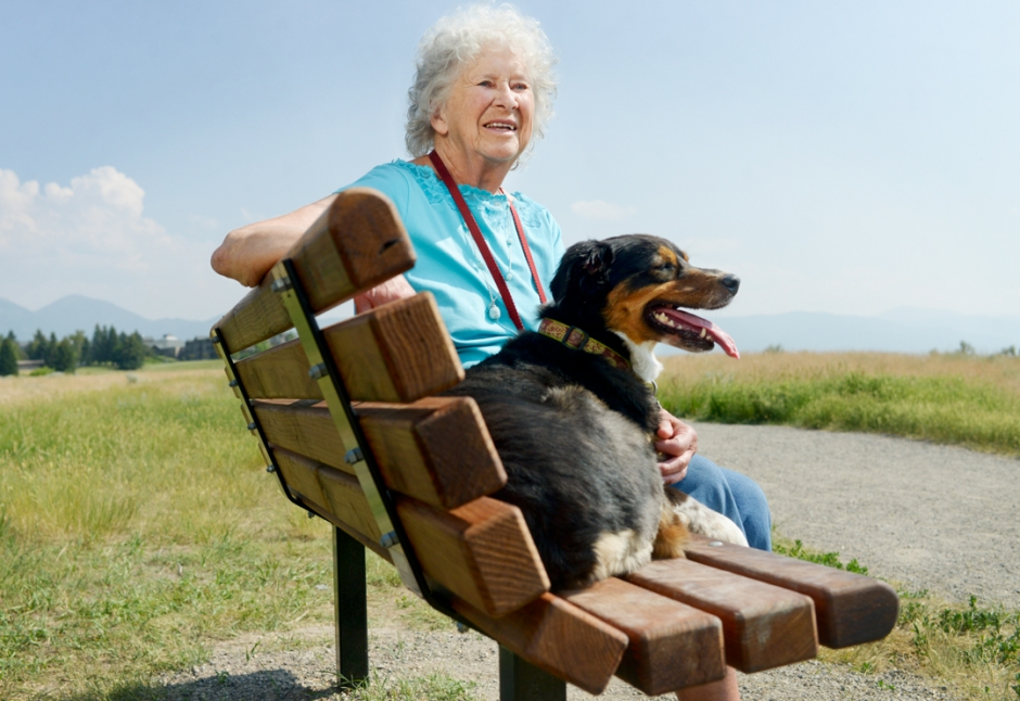 Mike Greener/Chronicle Long time Bozeman resident Mary Vant Hull and her dog Jewel, 7, sit on a bench in Burke Park that was dedicated to her for her years of service to the community Thursday afternoon.