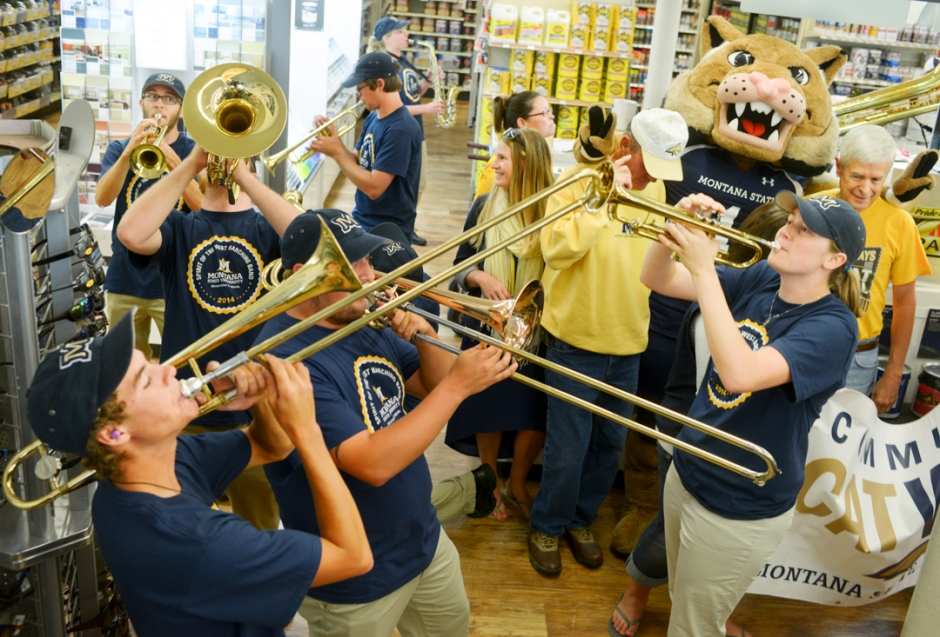 Mike Greener/Chronicle  Members of the Montana State University Spirit of the West marching band swarm the isles of ACE Hardware playing school fight songs in downtown Bozeman Friday morning as part of the 5th Annual MSU Cat Walk.