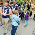 Mike Greener/Chronicle  Members of the Montana State University football team along with President Waded Cruzado walk in the 5th Annual MSU Cat Walk in downtown Bozeman Friday morning.