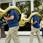 Mike Greener/Chronicle  Maggie Hammett, right, cheers on members of the Montana State University Spirit of the West marching band as they march in downtown Bozeman Friday morning as part of the 5th Annual MSU Cat Walk.