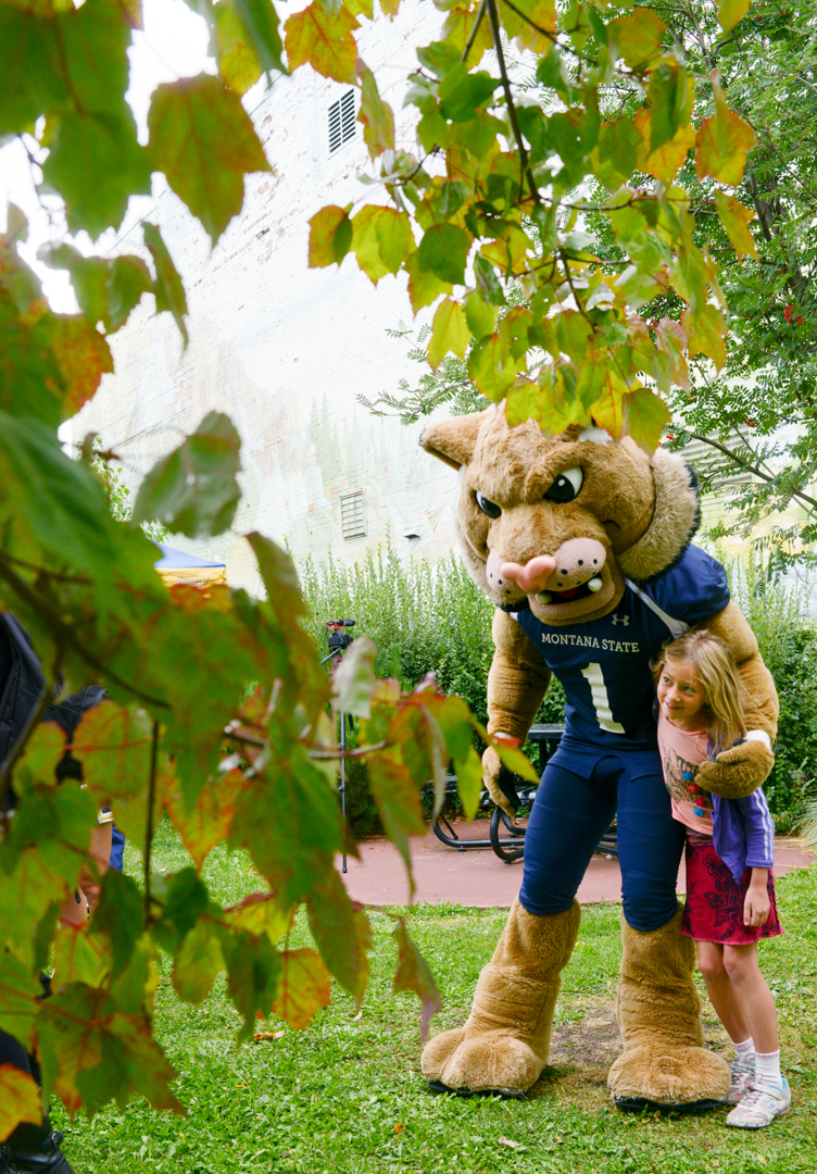 """Mike Greener/Chronicle  Montana State University mascot """"Champ"""" hugs a fan in downtown Bozeman Friday morning as part of the 5th Annual MSU Cat Walk."""