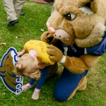 """Mike Greener/Chronicle  Montana State University mascot """"Champ"""" autographs the shirt of Lia Atkinson, 4, center, during the 5th Annual MSU Cat Walk in downtown Bozeman Friday morning."""